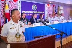 Command Master Chief Ryan Resurreccion serves as master of ceremonies during the Pacific Partnership 2019 opening ceremony in Tacloban. (U.S. Navy/MC2 Nicholas Burgains)