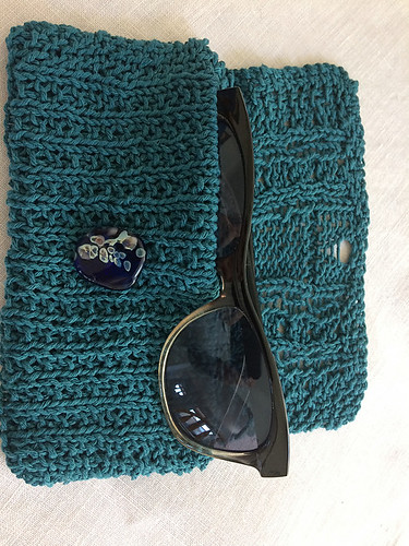 Kathy knit herself RJ Reidel's Think Spring! Sunglass Case with her sample ball of Berroco Mantra in her Yarn Tasting bag!