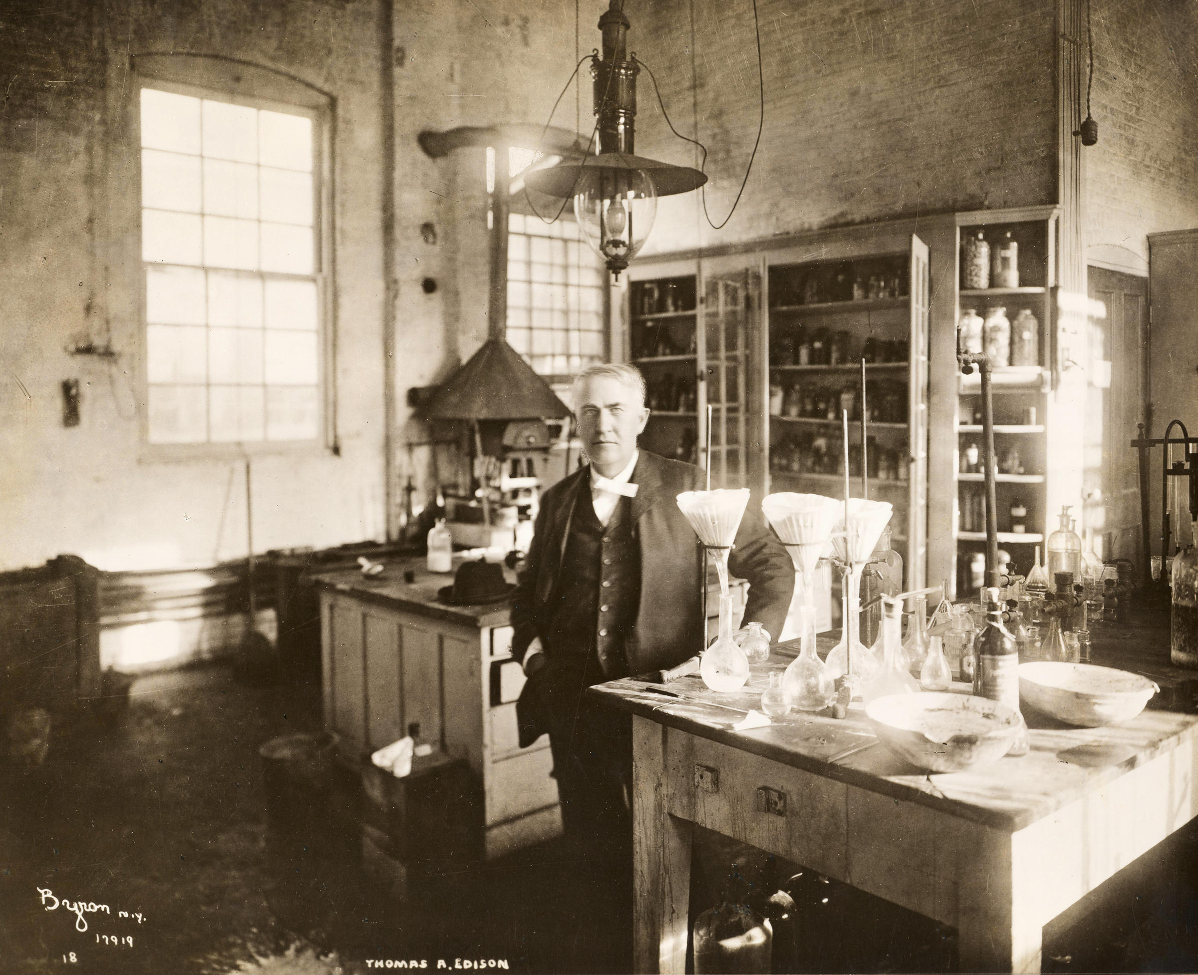 Thomas Edison stands in his chemistry lab in West Orange, New Jersey, in 1904.
