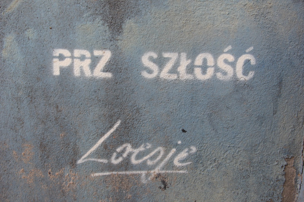 The past and the future | Loesje (street art, Warsaw)