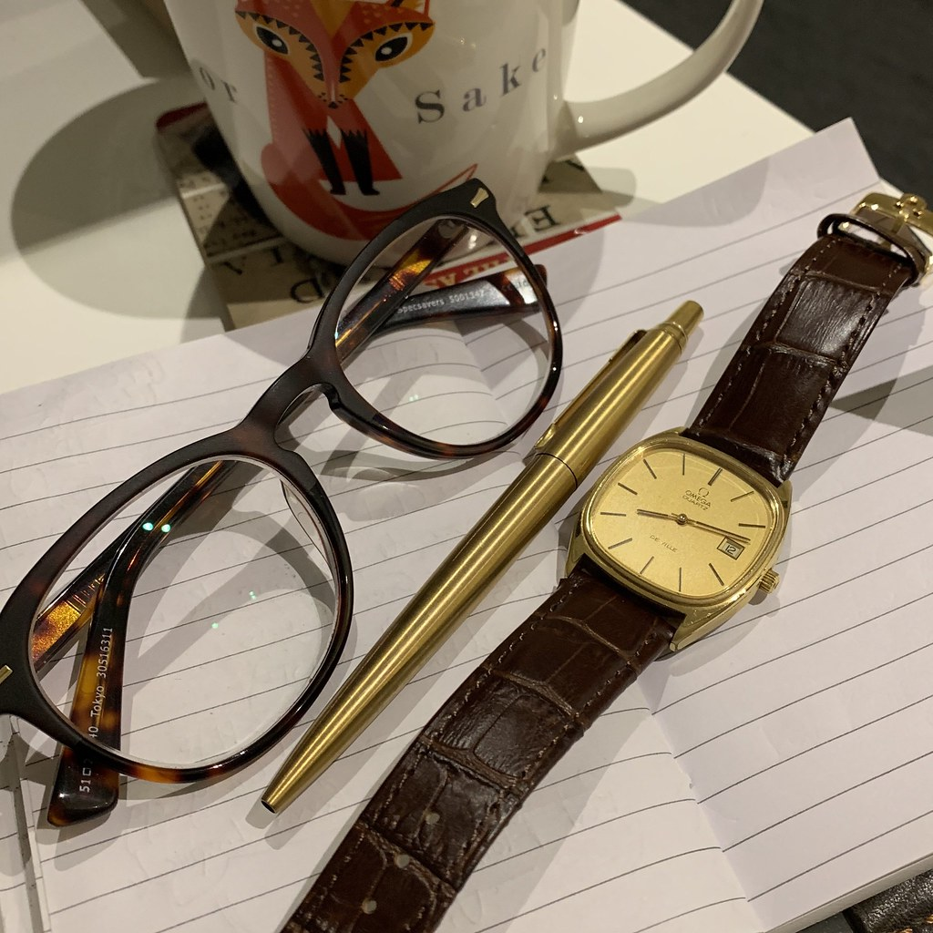 Omega De Ville Megaquartz with coffee