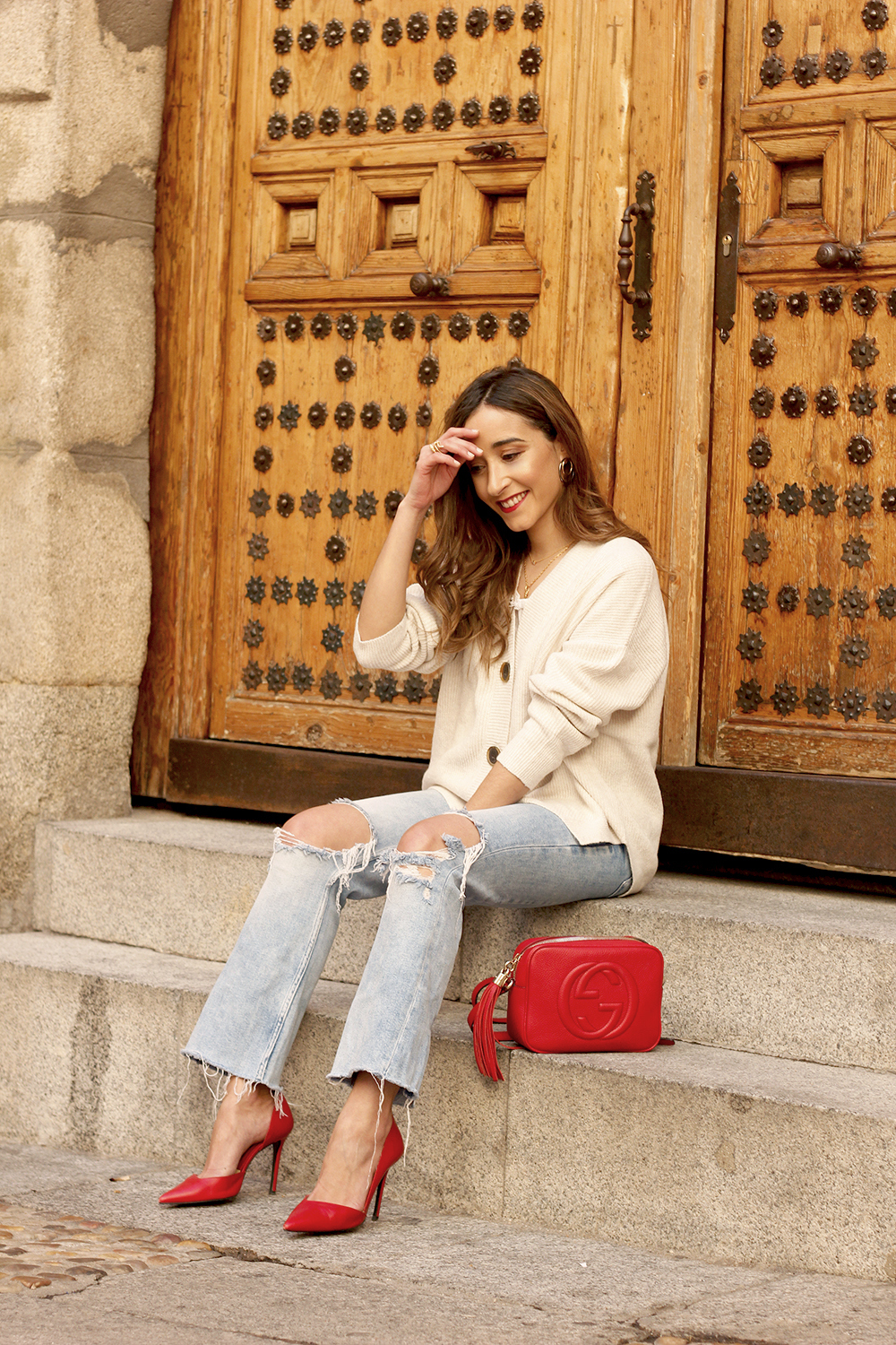 beige cardigan gucci bag red heels ripped jeans street style outfit 20198