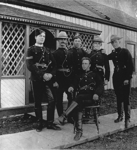Mounted police, circa1900, wearing the new uniform of red, prairie-style tunics and Stetson hats.