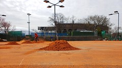 Resurfacing The Clay Courts At The Tennis Club