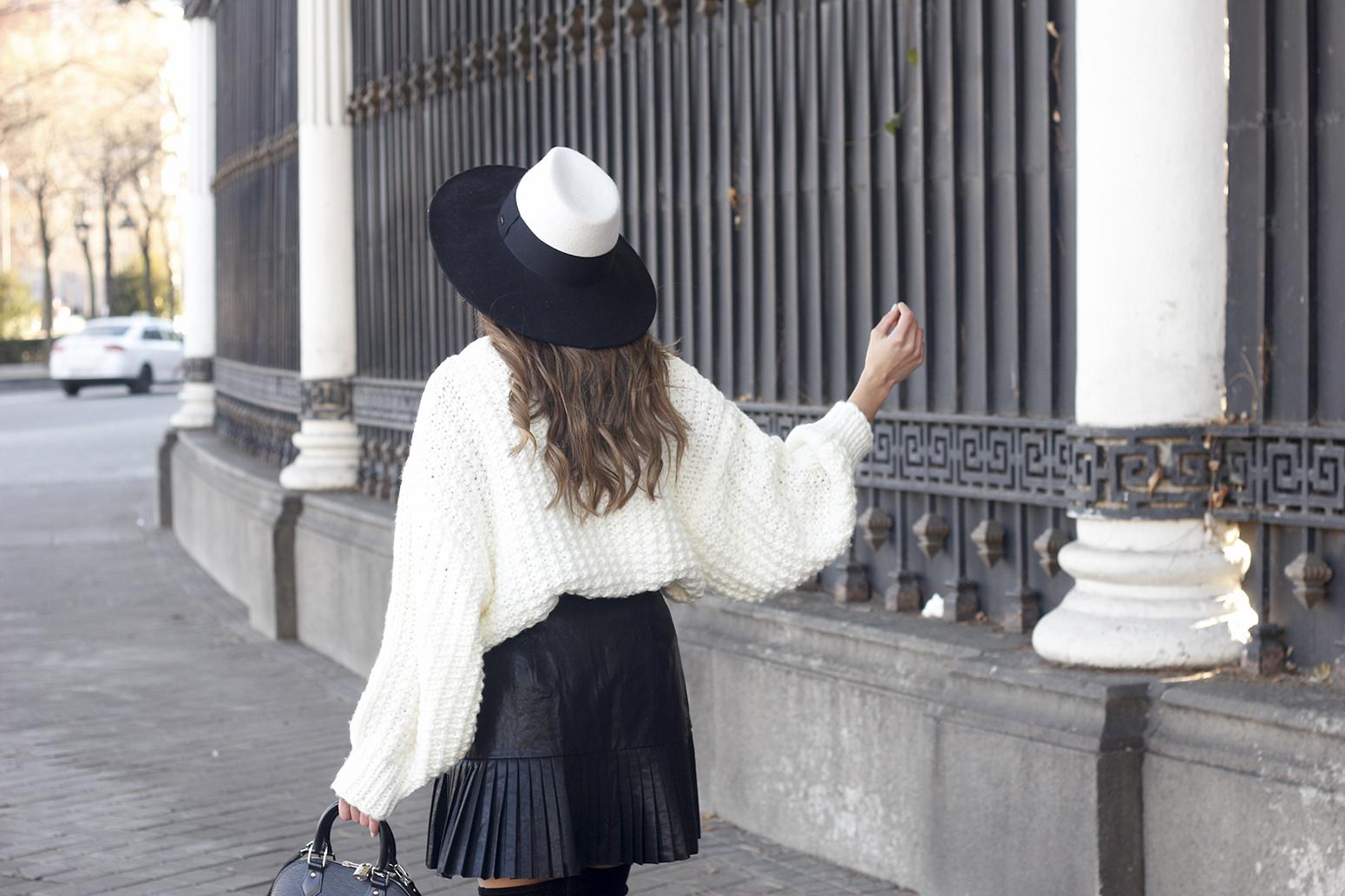 black pleated skirt  white sweater louis vuitton bag street style inspiration 201912