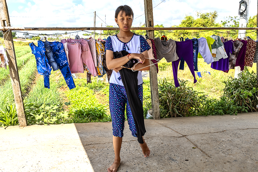 Girl with laundry--Vinh Chau