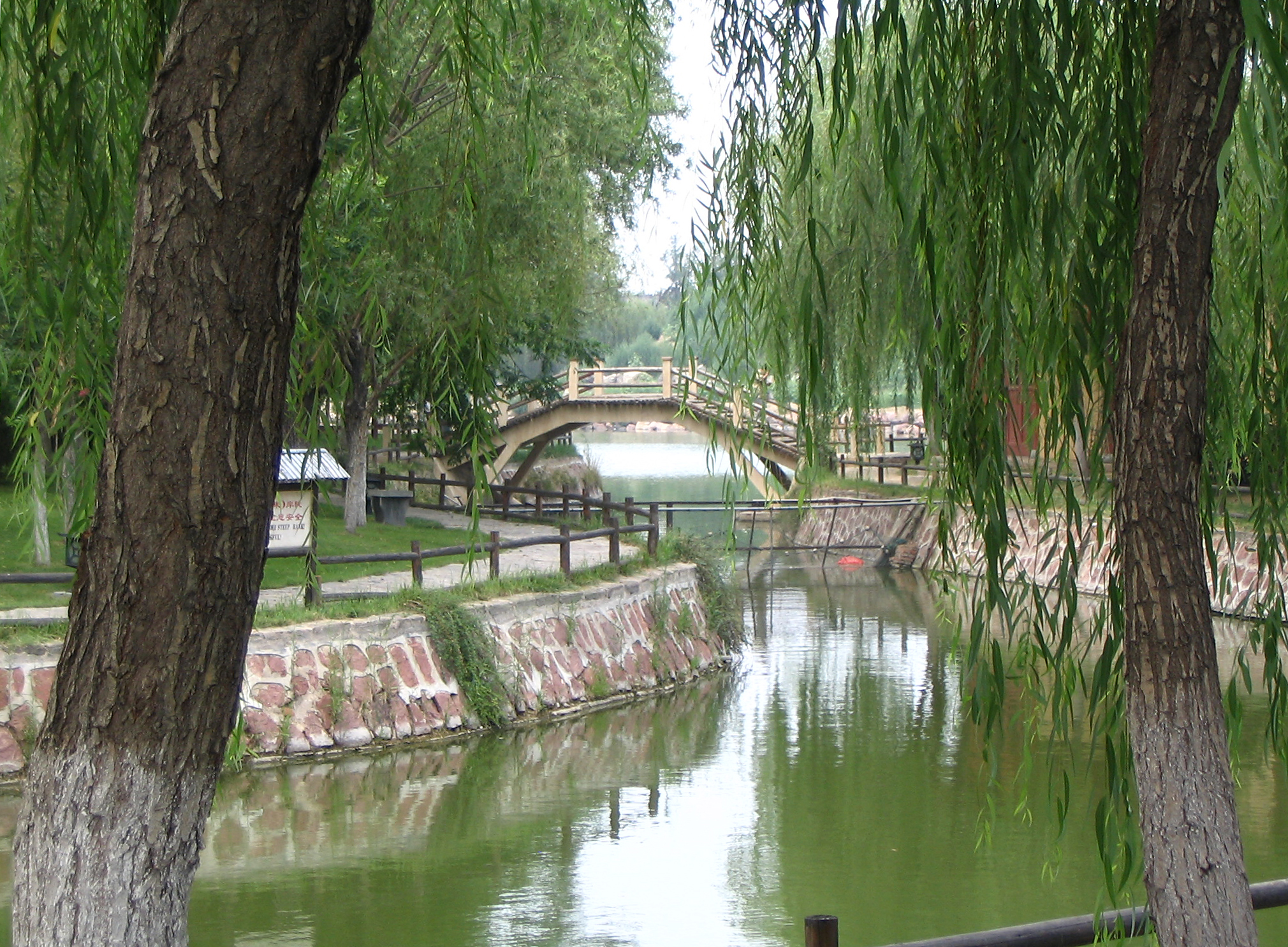 Small Bridge at Qingming Riverside Landscape Garden, Kaifeng, China. Photo taken on July 19, 2005.