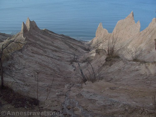 There are large gullies between the ridges of formations at Chimney Bluffs State Park, New York