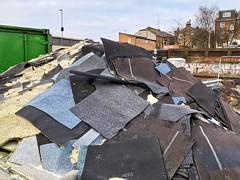 A pile of carpet tiles along the railway