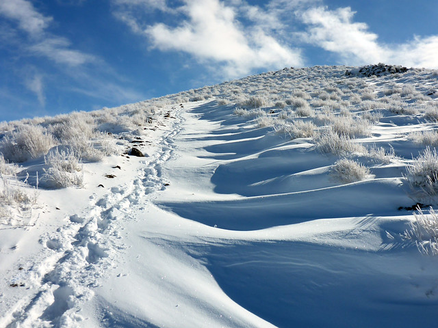 Steep climb through drifts