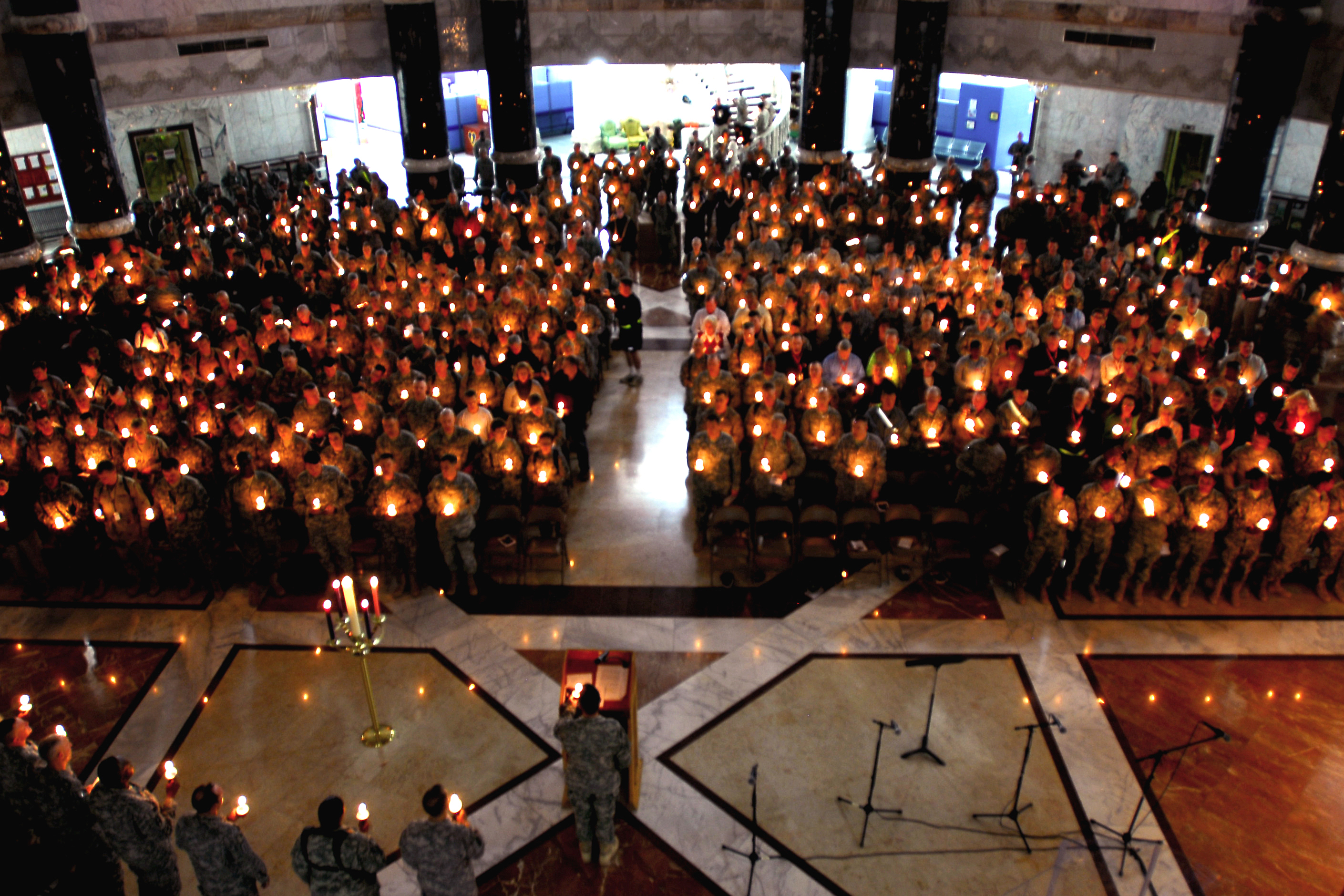 Service members at Victory Base Complex, Iraq, attend the Christmas Eve Candlelight Service at Al Faw Palace, Baghdad, Iraq, Decembrt 24, 2008. U.S. Army photo by Spc. Eric J. Glassey