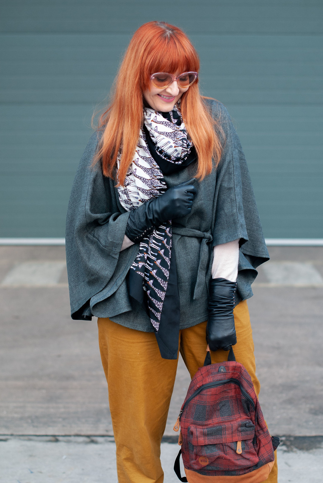 How to Make a Plain Grey Poncho Much More Exciting \ with mustard peg leg trousers \ giraffe print scarf \ black ankle boots \ tartan plaid backpack \ pastel sunglasses | Not Dressed As Lamb, over 40 style