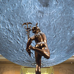 Moon at the Harris Museum by a statue