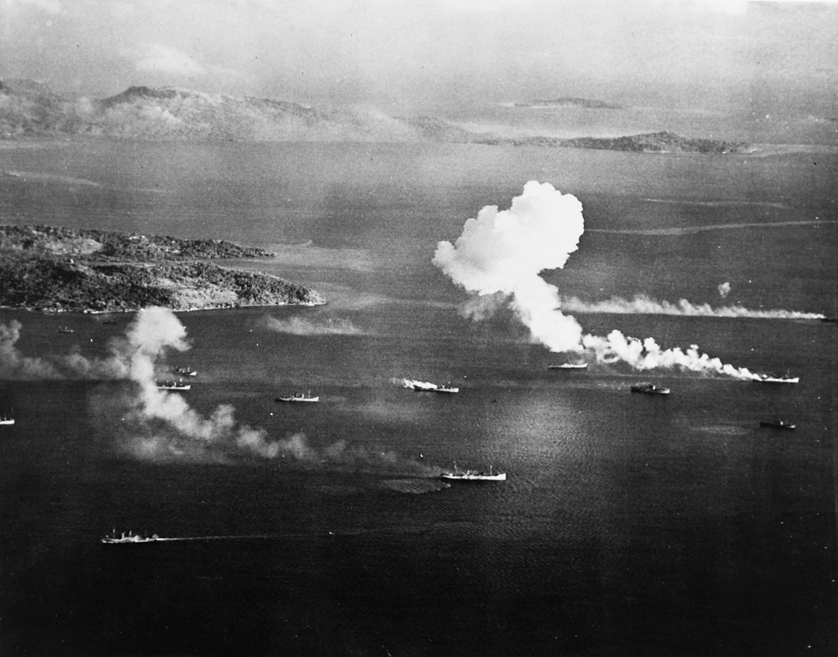 Japanese shipping under air attack in Truk Lagoon, as seen from a USS Intrepid (CV-11) aircraft on the first day of raids, February 17, 1944. Dublon Island is at left, with Moen Island in the background. Four of these ships appear to have been hit by this time. Naval History and Heritage Command, National Archives photo 80-G-215151.