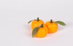 Fresh orange fruits on white background