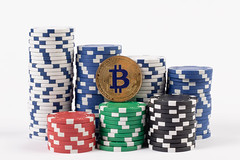 Big stack of poker chips with golden Bitcoin