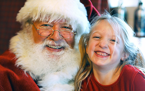 A Little Girl With Santa