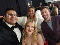 Farhan Merchant, Carolyn Ratcliffe, Heidi Klum, and Paul Salfen pose together on the red carpet of the 2019 GRAMMY Awards