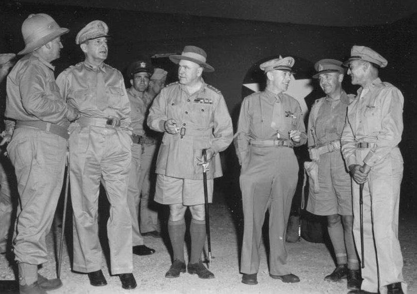 Senior Allied commanders at Seven Mile Drome at Port Moresby, New Guinea, in October 1942. Left to right: Mr Frank Forde (Australian Minister for the Army); MacArthur; General Sir Thomas Blamey, Allied Land Forces; Lieutenant General George C. Kenney, Allied Air Forces; Lieutenant General Edmund Herring, New Guinea Force; Brigadier General Kenneth Walker, V Bomber Command.