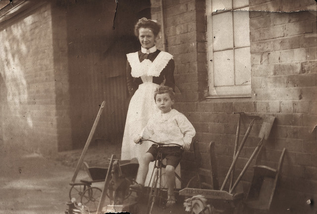 Boy with tricycle and nurse