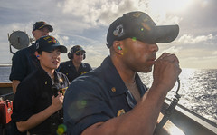 Chief Master-at-Arms Nicholas Graham gives the order to fire on a target during a live-fire gunnery exercise in the Philippine Sea aboard USS Milius (DDG 69) in March. (U.S. Navy/MC1 Rufus Hucks)