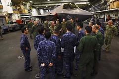 U.S. and Japan military officials discuss the F-35B Lightning II aircraft aboard USS Wasp (LHD 1), Feb. 5. (U.S. Navy/MC3 Sean Galbreath)