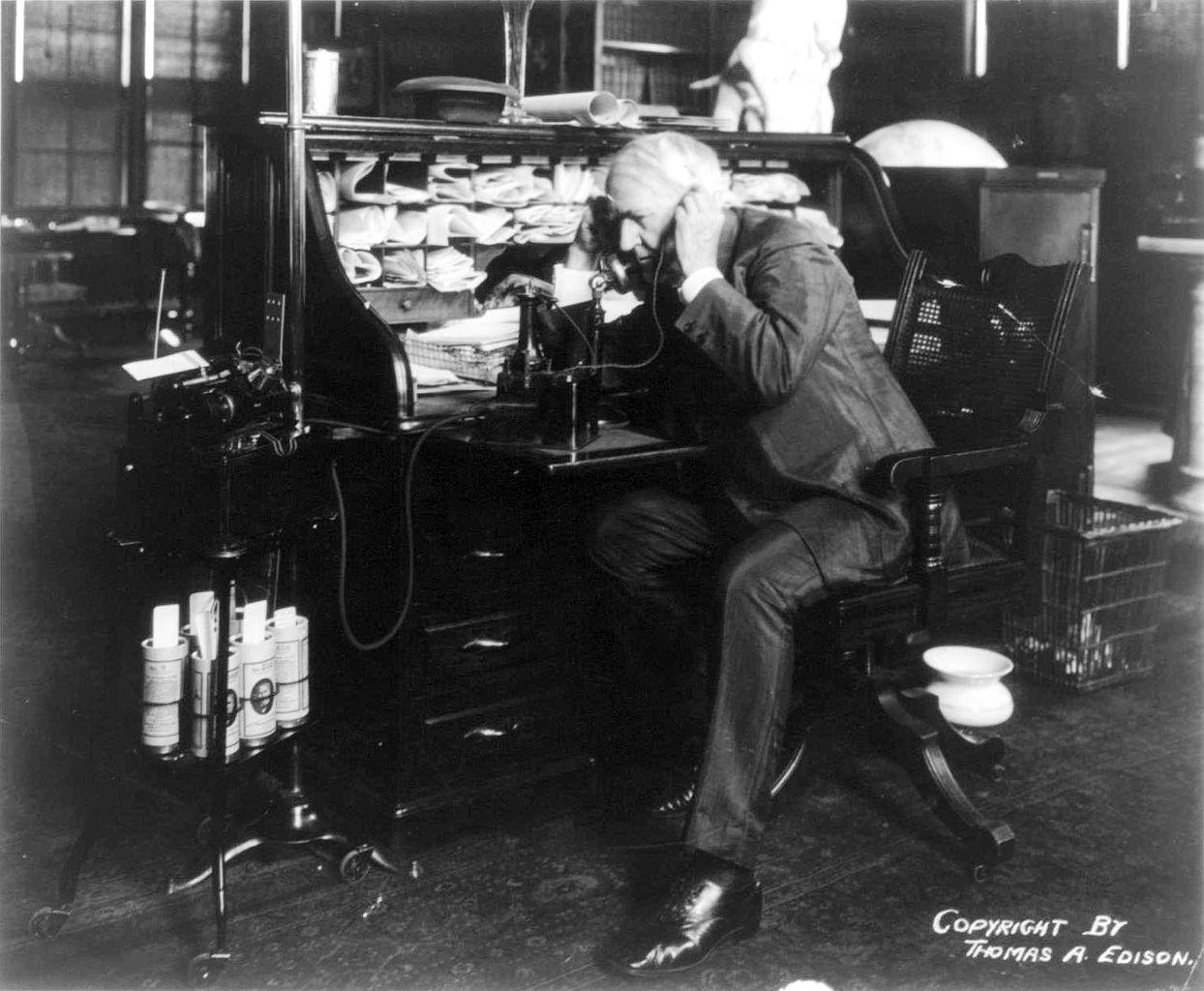 Thomas Edison using his dictating machine.