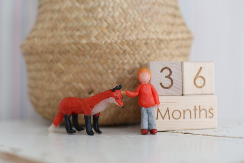 Baby F and a fox - beeswax figures made by C