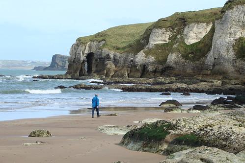 Person walking at Whiterocks Beach