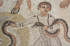 Punishment Mosaic depicting boy with serpents 1200X800