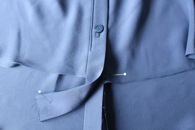 Blue dart shirt hemming details