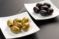Green and Black Olives on the plate