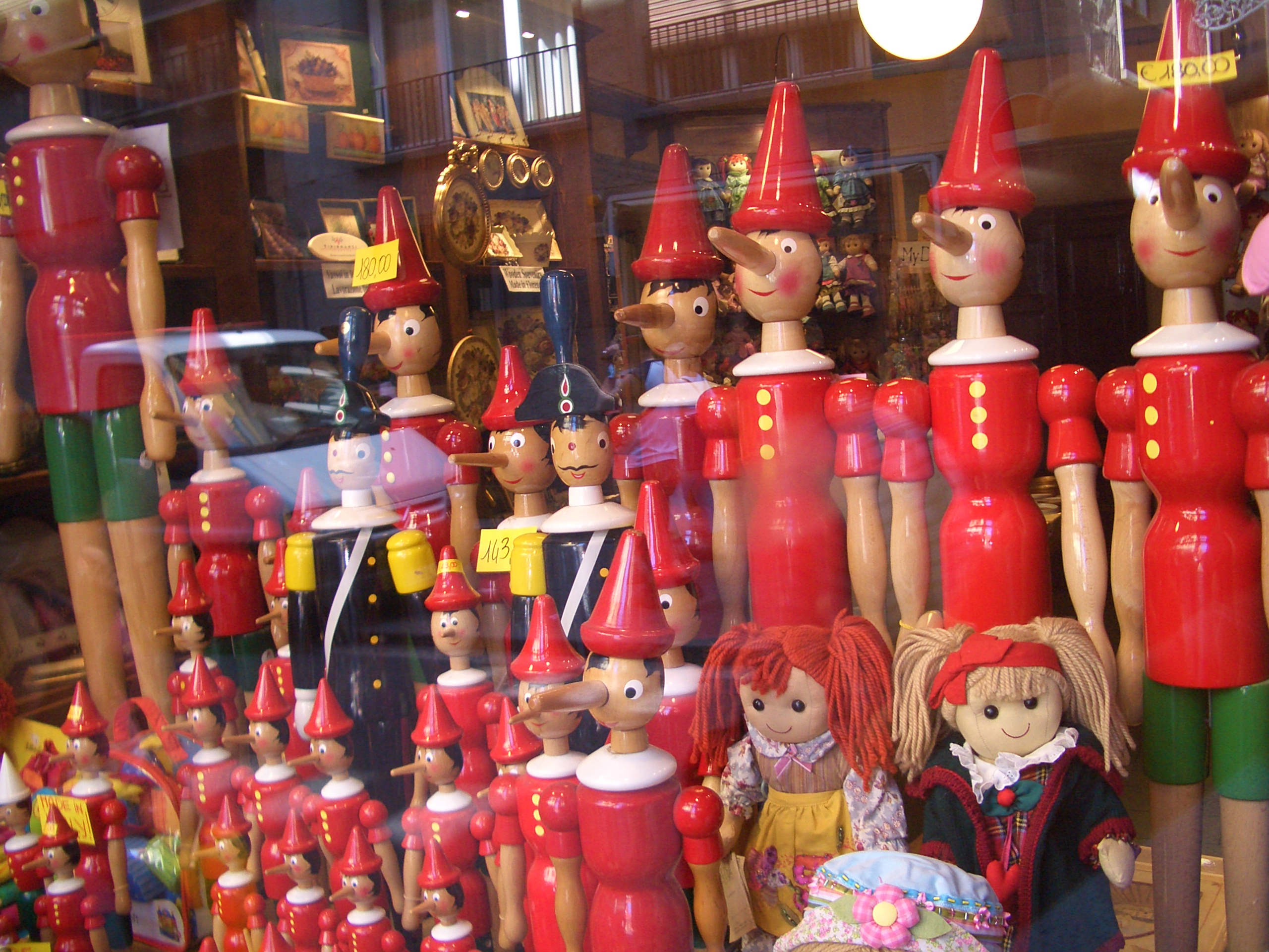Pinocchio dolls in a shop window in Florence. Photo taken by <a href+
