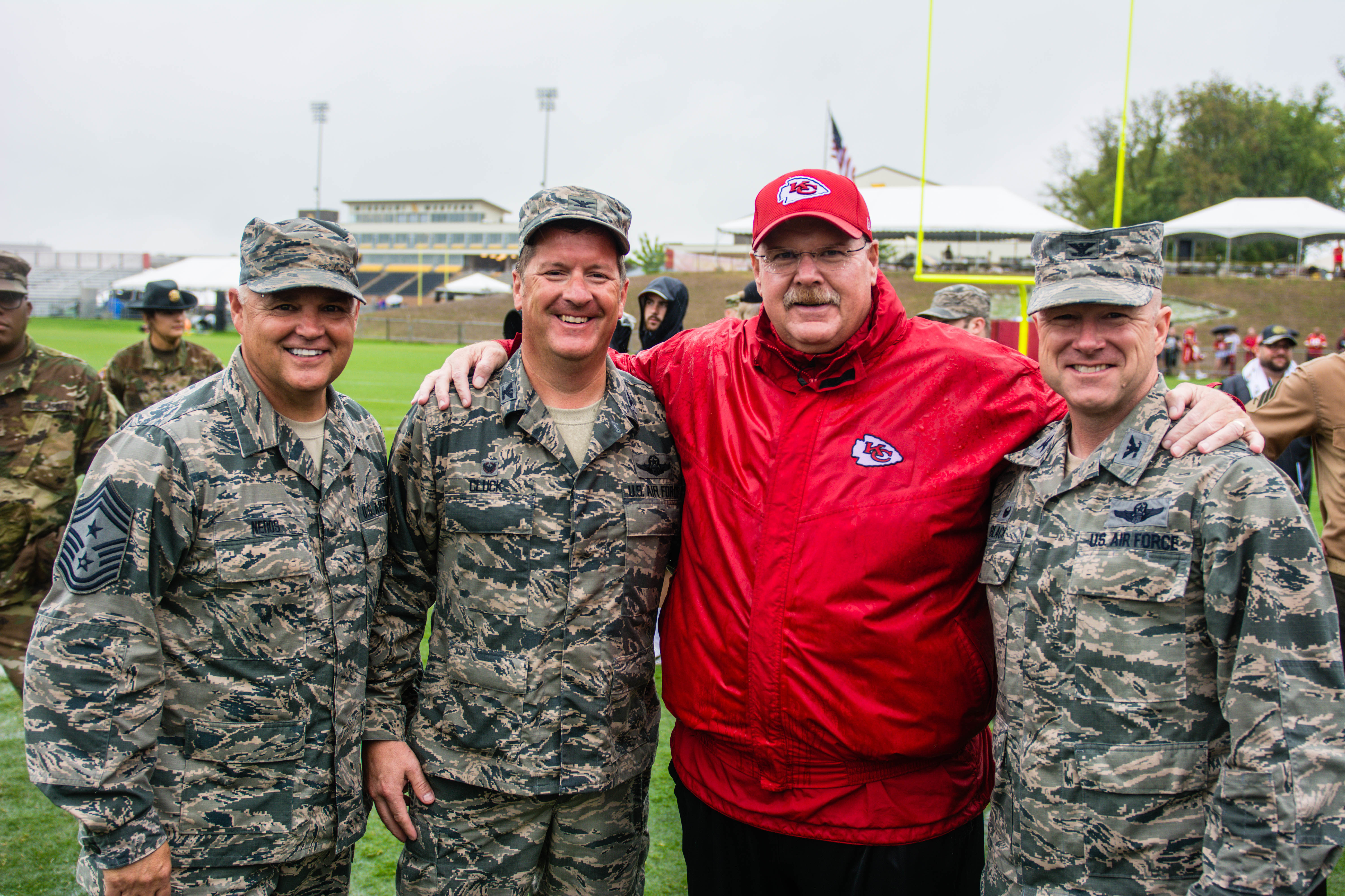 Andy Reid, head coach of the Kansas City Chiefs football team, poses for a photo with leadership of the 139th Airlift Wing, Missouri Air National Guard, at the Chief's training camp in St. Joseph, Missouri, August 14, 2018. The Chiefs hosted a military appreciation day on their final day of training. (U.S. Air National Guard photo by Master Sgt. Michael Crane)