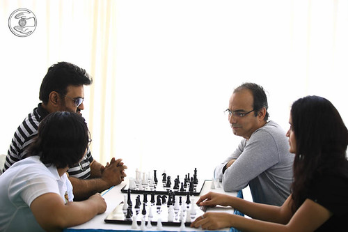 Devotees playing Chess
