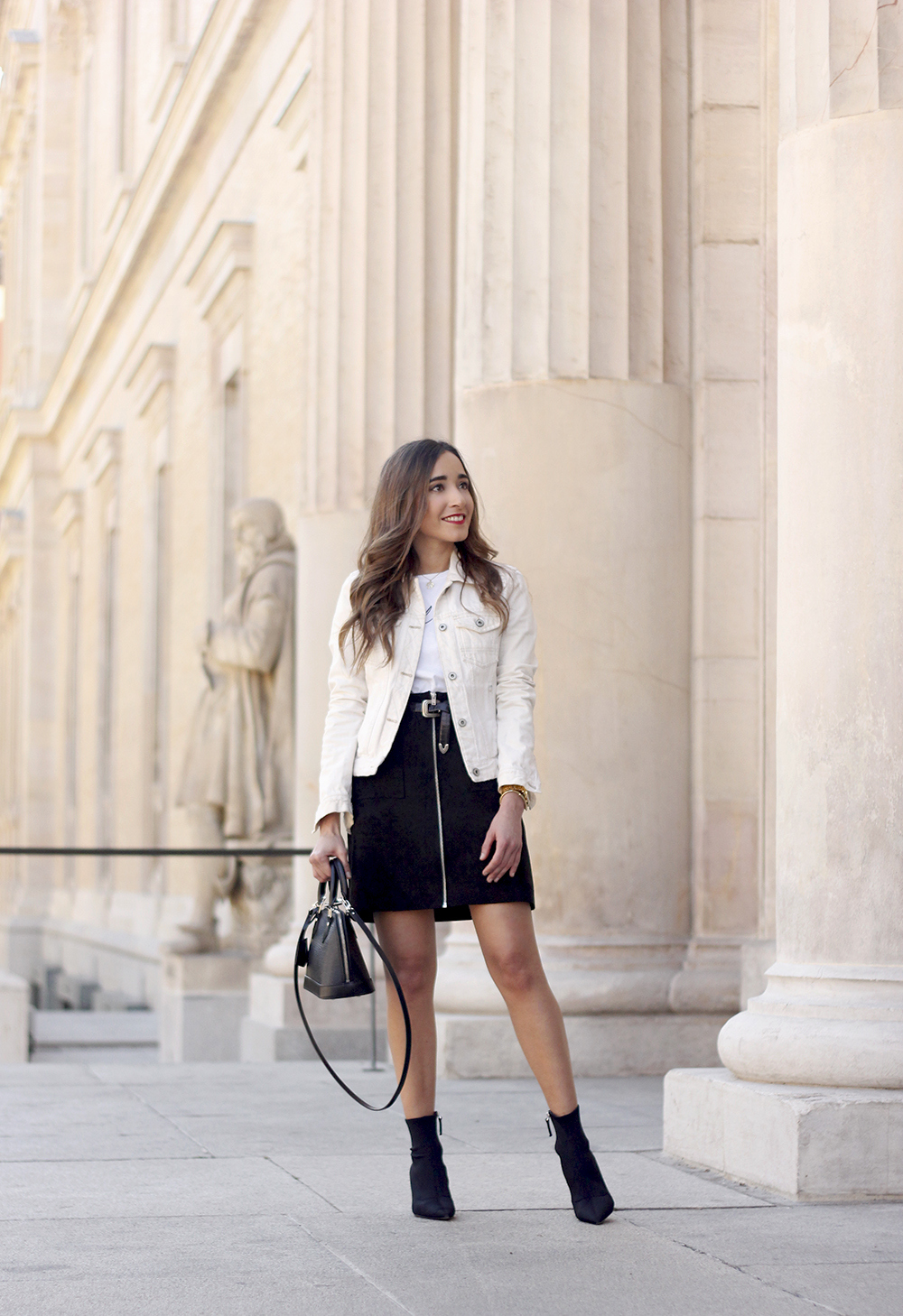 suede black skirt uterqüe ankle boots denim jacket louis vuitton bag street style outfit 20196