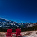 Parks Canada Red Chairs under the Winter Stars at Mount Rundle