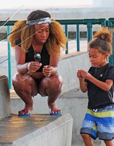 Teaching her how to bait a hook - Vero Beach, FL