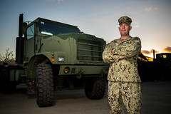 TINIAN, Northern Mariana Islands (Jan. 14, 2019) Chief Construction Mechanic Robin Nicely, from Arvada, Colo., assigned to Naval Mobile Construction Battalion 3, Det. Tinian, poses for a portrait in front of a Medium Tactical Vehicle Replacement Mark 31 tractor trailer during recovery relief efforts. Service members from Joint Region Marianas and U.S. Indo-Pacific Command are providing Department of Defense support to the Commonwealth of the Northern Mariana Islands' civil and local officials as part of the Federal Emergency Management Agency-supported Super Typhoon Yutu recovery efforts. (U.S. Navy photo by Mass Communication Specialist 2nd Class Kelsey J. Hockenberger)