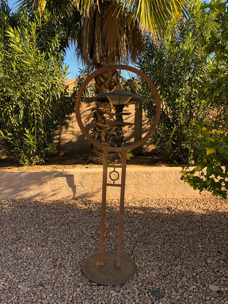 An old metal bird feeder in the backyard of our rental house in Scottsdale, Arizona