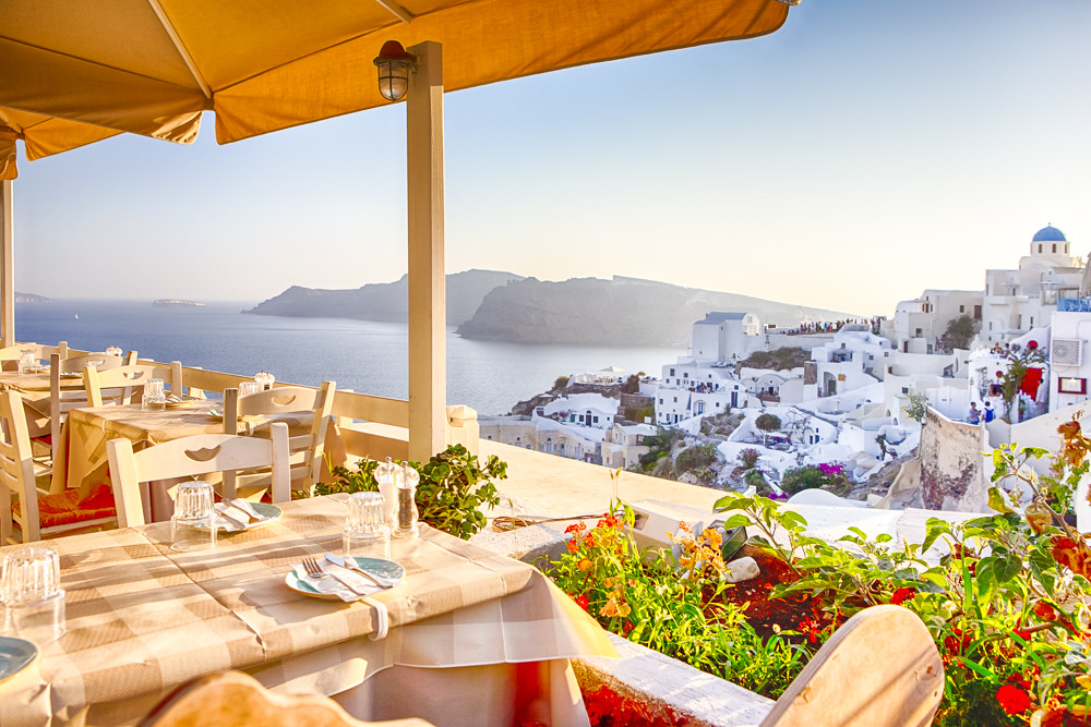 Open Air Cosy Restaurant in Beautiful Oia Village on Santorini Island in Greece Straight Before the Sunset.