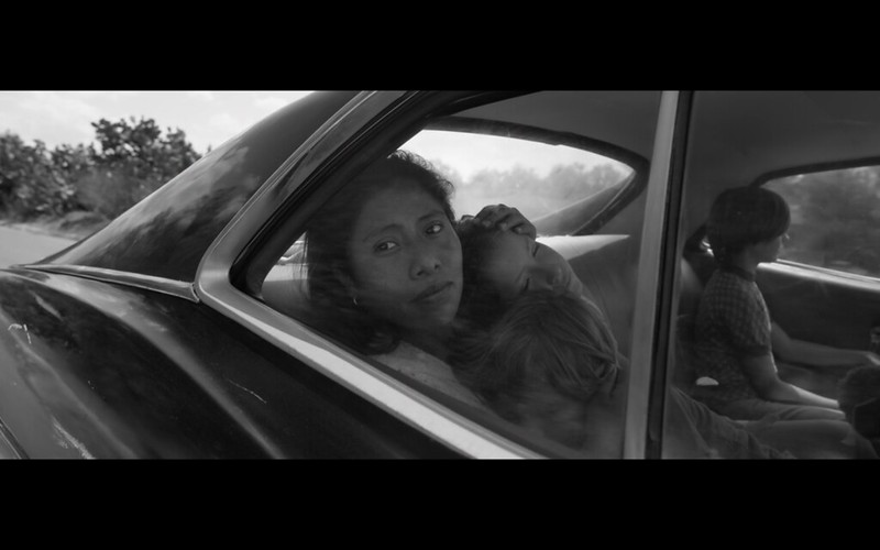 "Movie Review: ""Roma,"" in hazy, black-and-white shots, dazzles"