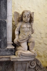 glum cherub on the Swift memorial (1645)