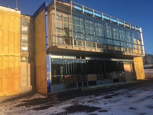 Exterior windows being installed.