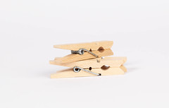 Wooden clothes pins on white background