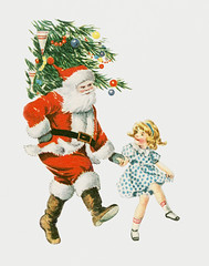 Santa and a child dancing