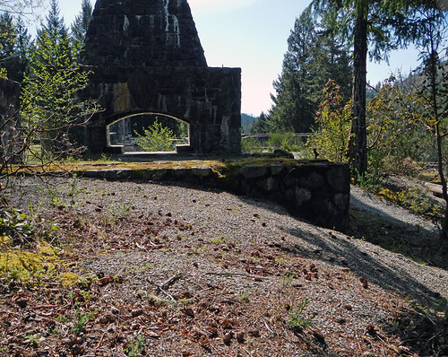 Old stone chimney is all that remains of the ruins of a lodge at Sooke Potholes Park on Vancouver Island, Canada