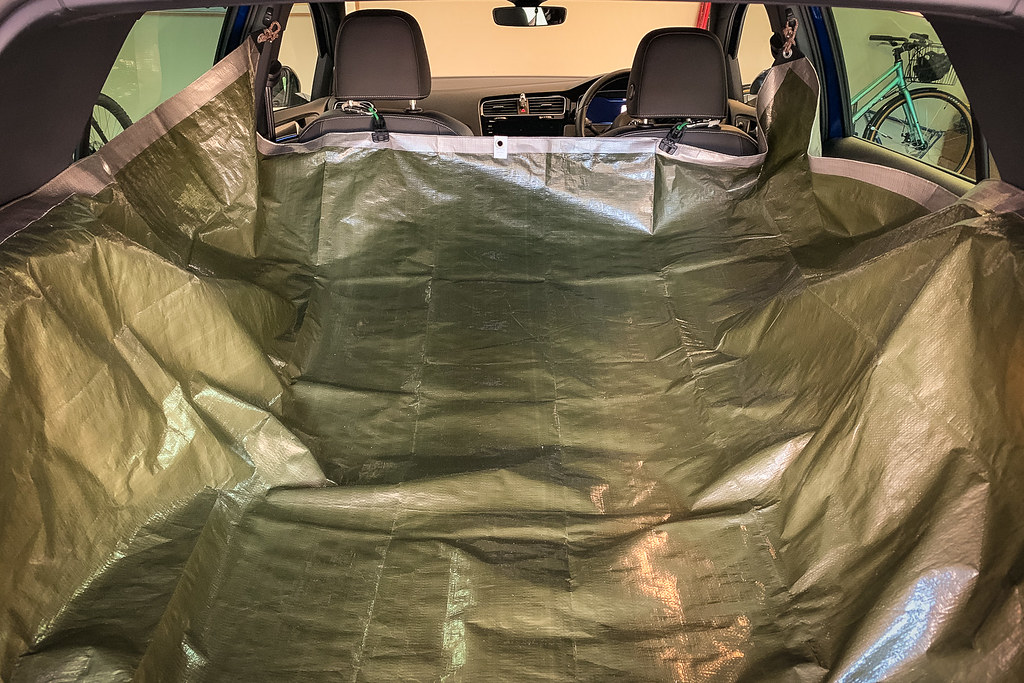 Large green tarp covering the inside of a hatchback