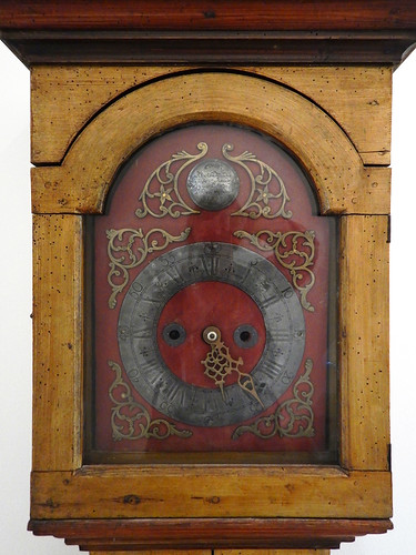 Silkeborg, Denmark: the clockface on a Danish grandfather's clock in the local museum