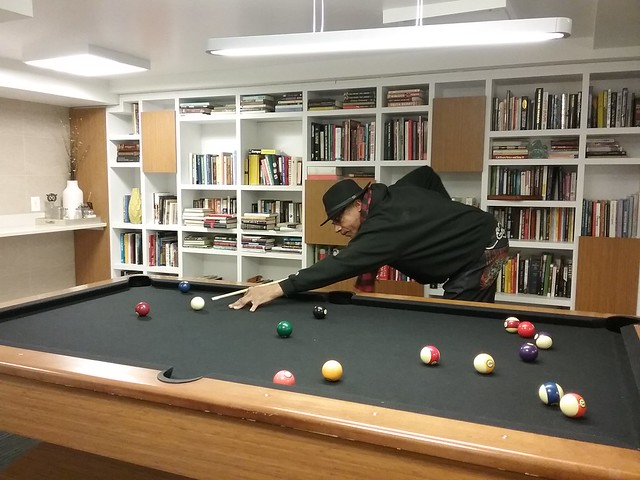 A photo of Moyo playing pool.